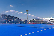 General view of the pitch being watered before the Vitality Hockey Women's World Cup 2018 Bronze Medal match between Australia and Spain, at the Lee Valley Hockey and Tennis Centre, QE Olympic Park, United Kingdom on 5 August 2018. Picture by Martin Cole.