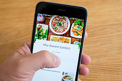 UberEats app for restaurant delivery services in London shown on an iPhone 6 smartphone