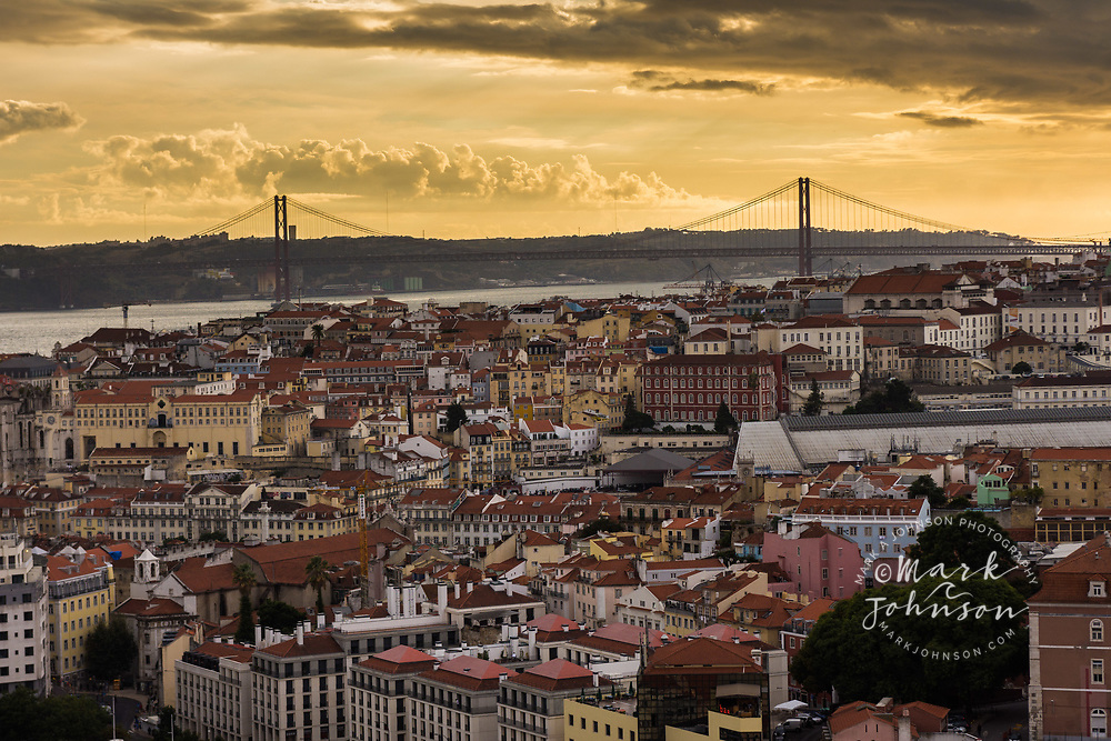 A late afternoon vista of Lisbon, Portugal, showing the 25th of April Bridge over the Tagus River