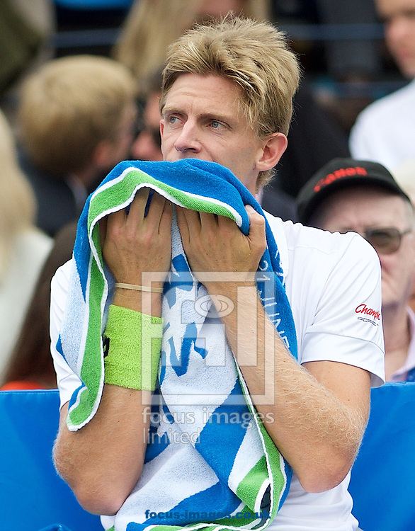 Kevin Anderson of South Africa towels down during his semi-final match against Giles Simon of France in Aegon Championships at the Queen's Club, West Kensington<br /> Picture by Alan Stanford/Focus Images Ltd +44 7915 056117<br /> 20/06/2015