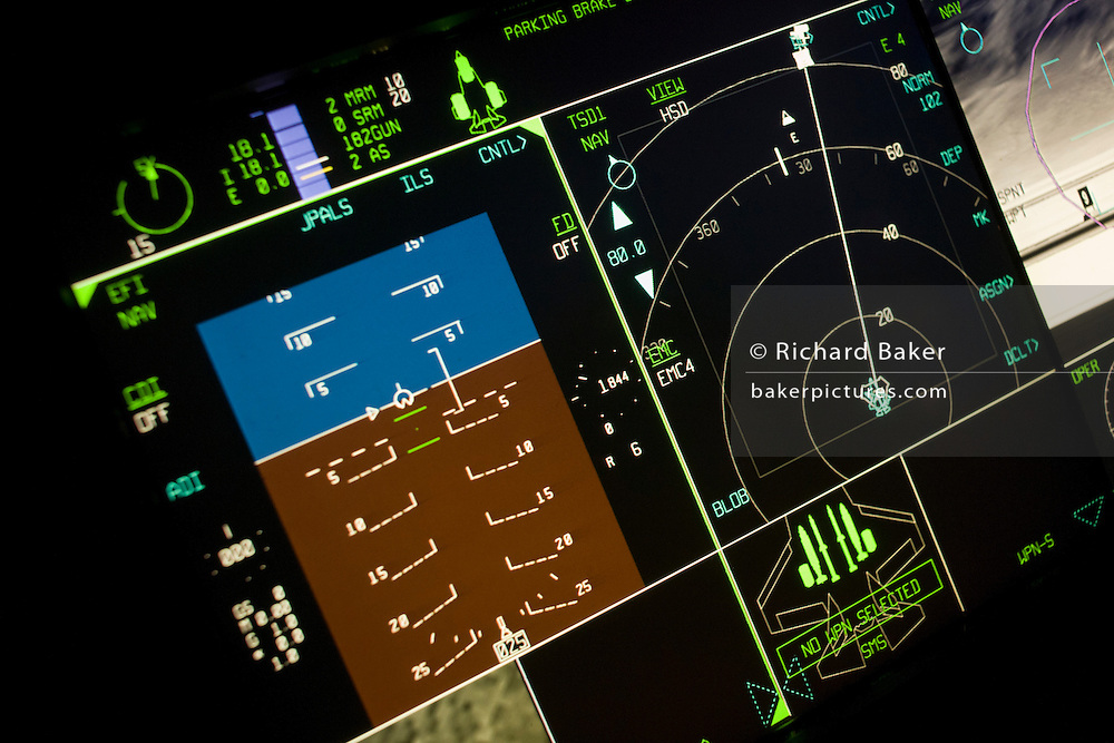 Glowing cockpit instrumentation of a Lockheed Martin F-35 Lightning II stealth fighter. The F-35 Lightning II is a fifth-generation, single-seat, single-engine stealth multi-role fighter that can perform close air support, tactical bombing, and air defence missions. The F-35 is descended from the X-35, the product of the Joint Strike Fighter (JSF) program. Its development is being principally funded by the United States, with the United Kingdom and other partner governments providing additional funding. It is being designed and built by an aerospace industry team led by Lockheed Martin with Northrop Grumman and BAE Systems as major partners. The F-35's first flight took place on 15 December 2006. The US intends to buy a total of 2,443 aircraft for an estimated US$323 billion, making it the most expensive defense program ever.[