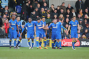 AFC Wimbledon players celebrating after AFC Wimbledon defender Sean Kelly (22) scores 2-1 during the EFL Sky Bet League 1 match between AFC Wimbledon and Oxford United at the Cherry Red Records Stadium, Kingston, England on 14 January 2017. Photo by Matthew Redman.