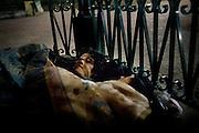 [English]  Ali-Reza and Madjid, both 15, sleeping under the bandstand of Villemin park. Afghan refugees are often waken up and violently chased away from the park by the police.<br /> <br /> [Francais] Ali-Reza s'est glisse sous la couverture de Madjid, a l'abri du kiosque a musique du jardin..En août 2008, de violentes incursions de la police ont eu lieu plusieurs jours de suite au milieu de la nuit, destinees a faire fuir les migrants a l'aide de gaz anti-emeute. Aucun evenement particulier ces jours-la ne peut expliquer ces actes, mis a part une reponse de l'etat suite a la lettre ouverte du Maire de Paris, Bertrand Delanoë, demandant a la ministre du logement, Christine Boutin, d'augmenter les capacites d'accueil des migrants du Xeme arrondissement.