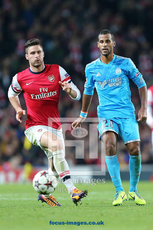 Picture by Richard Calver/Focus Images Ltd +447792 981244<br /> 26/11/2013<br /> Olivier Giroud of Arsenal and Alaixys Romao of Olympique de Marseille during the UEFA Champions League match at the Emirates Stadium, London.