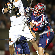 Dave Lawson #2 of the Rochester Rattlers is hit during the game at Harvard Stadium on August 9, 2014 in Boston, Massachusetts. (Photo by Elan Kawesch)