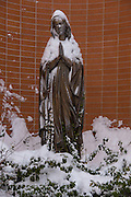A statue of Our Lady of Lourdes is covered with snow outside of Our Lady of Lourdes Church in De Pere, Wis. (Sam Lucero photo)