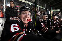 KELOWNA, BC - FEBRUARY 17: Luke Prokop #6 of the Calgary Hitmen sits on the bench and hams it up for the camera during third period against the Kelowna Rockets at Prospera Place on February 17, 2020 in Kelowna, Canada. (Photo by Marissa Baecker/Shoot the Breeze)