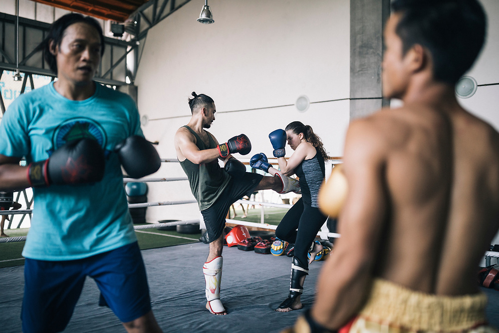 Chiang Mai, Thailand -- May 19, 2017: Boxers and trainees sparring at the Chiangmai Muay Thai Training Center in northern Thailand.