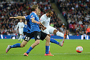 England striker Theo Walcott has a shot during the Group E UEFA European 2016 Qualifier match between England and Estonia at Wembley Stadium, London, England on 9 October 2015. Photo by Alan Franklin.