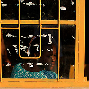 A member of the Burundian National Independent Electoral Commission is seen through a window at a polling station Bujumbura.