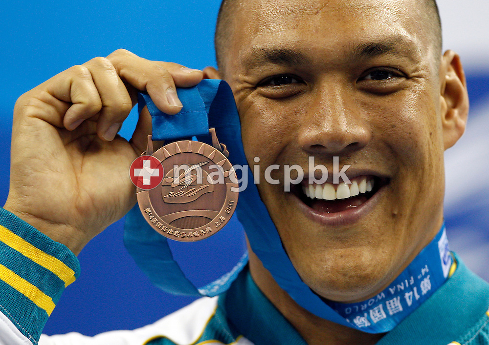 3rd placed Geoff HUEGILL of Australia poses with his bronze medal during the award ceremony for the men's 50m Butterfly Final during the 14th FINA World Aquatics Championships at the Oriental Sports Center in Shanghai, China, Monday, July 25, 2011. (Photo by Patrick B. Kraemer / MAGICPBK)