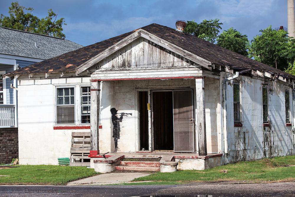 Bansky painting on a home destroyed by Hurricane Katrina in New Orleans 9th Ward.