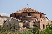 The Church of Santa Fosca dates from the 1000s AD (as does the adjacent Cathedral of Santa Maria Assunta) on Torcello island in the Venice Lagoon, Italy, Europe. Italy's Veneto region is named for the ancient Veneti people from the 900s BC. Over a hundred small islands spread across the marshy Venetian Lagoon along the Adriatic Sea in northeast Italy, between the mouths of the Po and Piave Rivers. Barbarian invasions, such as Huns in 452 AD, drove mainland Veniti people to settle the islands. The population of Torcello peaked in the 900s AD with more people than the city of Venice. The Republic of Venice was a major maritime power during the Middle Ages and Renaissance, a staging area for the Crusades, and a major center of art and commerce (silk, grain and spice trade) from the 1200s to 1600s. The wealthy legacy of Venice stands today in a rich architecture combining Gothic, Byzantine, and Arab styles.