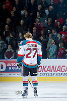 KELOWNA, CANADA - DECEMBER 27:  Ryan Olsen #27 of the Kelowna Rockets stands on the ice during the national anthem against the Kamloops Blazers at the Kelowna Rockets on December 27, 2012 at Prospera Place in Kelowna, British Columbia, Canada (Photo by Marissa Baecker/Shoot the Breeze) *** Local Caption ***