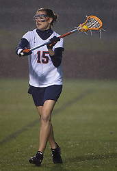 Virginia Cavaliers A Megan Havrilla (15) in action against Georgetown.  The Virginia Cavaliers Women's Lacrosse team hosted the Georgetown Hoyas at Klockner Stadium in Charlottesville, VA on April 11, 2007.  UVA lead GU 7-3 with 2:45 remaining in the first half.