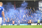 Oldham Athletic fans let off flares during the EFL Sky Bet League 2 match between Grimsby Town FC and Oldham Athletic at Blundell Park, Grimsby, United Kingdom on 15 September 2018.