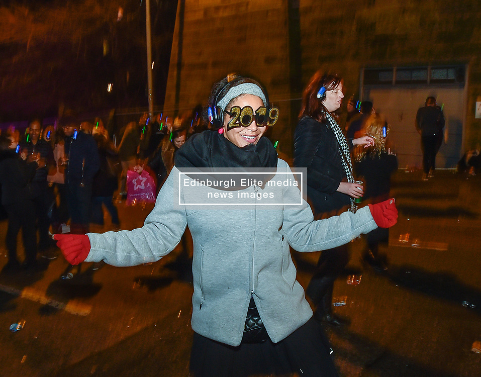 60,000 revellers packed into central Edinburgh to bring in the New Year. Franz Ferdinand headlined the concert in the gardens, with a spectacular firework display bringing in 2019.<br /> <br /> © Dave Johnston / EEm