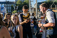 Clement Andre, 19, in sunglasses and other members of a Bagad Kombrid from Quimper celebrate their successful first day of competition at the Festival de Cornouaille on Saturday, July 23, 2016 in Quimper, France.