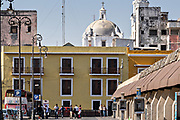 View of the Malecon looking back toward the dome of the Veracruz Cathedral in the historic center of the city of Veracruz, Mexico.