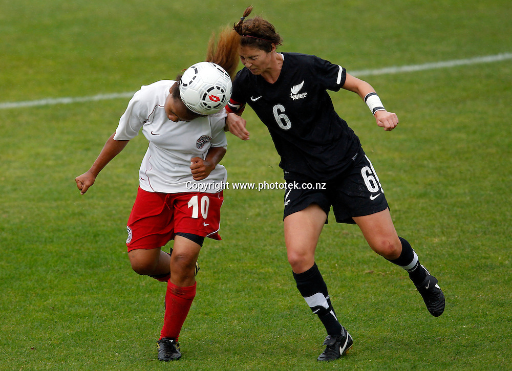 New Caledonia's Cheyenne Dieuma tangles with NZ's Hannah Carlsen. OFC U-17 Women's Championship, New Caledonia v New Zealand, Centre Park Mangere, Wednesday 11th April 2012. Photo: Shane Wenzlick