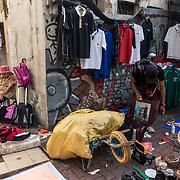 Sellers of Pasar Karat or flea market waiting for costumer at the back lane of Petaling Street in Kuala Lumpur on November 23, 2017.