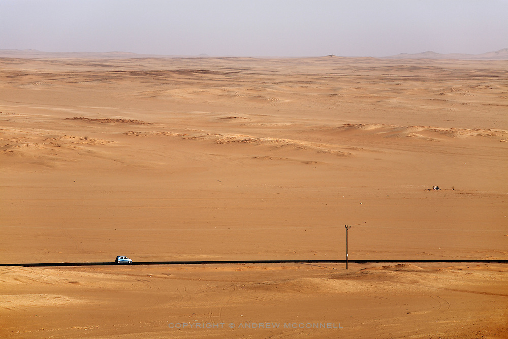 A car traverses the desert near the town of Karima, Sudan, on Tuesday, March 27, 2007.