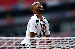 Fulham's Dennis Odoi climbs on top of a goal net as he celebrates after the final whistle during the Sky Bet Championship Final at Wembley Stadium