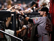 Sep. 14, 2012; Phoenix, AZ, USA; San Francisco Giants catcher Buster Posey (28) signs autographs for fans prior to the game against the Arizona Diamondbacks at Chase Field.  The Giants defeated the Diamondbacks 6-2. Mandatory Credit: Jennifer Stewart-US PRESSWIRE