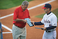 Former Ole Miss coach and two sport All-American Jake Gibbs (left) is presented a plaque by Mike Bianco at Ole Miss vs. Alabama at Oxford-University Stadium in Oxford, Miss. on Friday, April 12, 2013. Ole Miss won 6-0 to snap a 6 game losing streak.