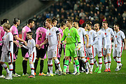 Teams shake hands during the The FA Cup Third Round Replay match between Milton Keynes Dons and Northampton Town at stadium:mk, Milton Keynes, England on 19 January 2016. Photo by Dennis Goodwin.