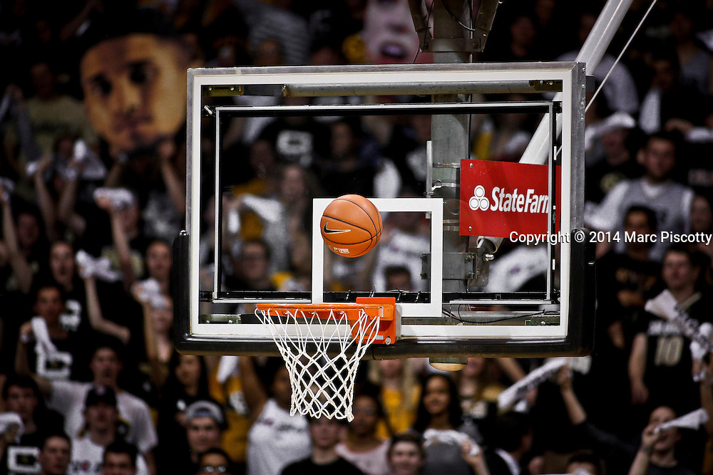 SHOT 2/19/14 11:27:03 PM - A shot rattles around the hoop before falling through during Colorado and Arizona State's regular season Pac-12 basketball game at the Coors Events Center in Boulder, Co. Colorado won the game 61-52.<br /> (Photo by Marc Piscotty / &copy; 2014)