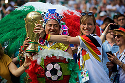MOSCOW, RUSSIA - Sunday, June 17, 2018: Mexico and Germany supporters with a World Cup trophy during the FIFA World Cup Russia 2018 Group F match between Germany and Mexico at the Luzhniki Stadium. (Pic by David Rawcliffe/Propaganda)