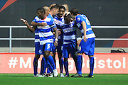 Queens Park Rangers midfielder Junior Hoilett celebrates with team mates after his goal during the Sky Bet Championship match between Bristol City and Queens Park Rangers at Ashton Gate, Bristol, England on 19 December 2015. Photo by Jemma Phillips.