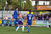 AFC Wimbledon defender Will Nightingale (5) beating Shrewsbury Town attacker Jason Cummings (35) to the ball and winning header during the EFL Sky Bet League 1 match between AFC Wimbledon and Shrewsbury Town at the Cherry Red Records Stadium, Kingston, England on 14 September 2019.