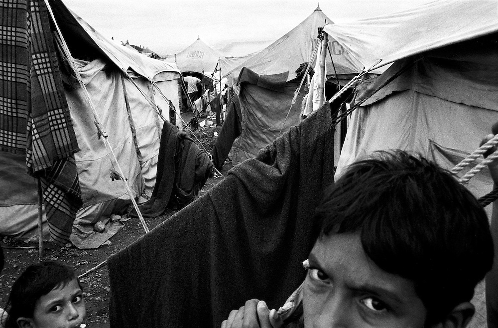 The tents were standing so close it was hard to move between them. When one collapsed, the surrounding ones collapsed aswell. It was a firetrap that the UNHCR were desperate to fix...Konik camp - a refugee camp for Roma (gypsies) displaced from Kosovo, Montenegro