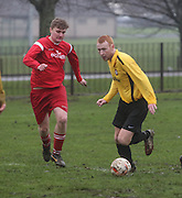 Occidental (red) against Fintry Athletic (yellow) in the Riverview Utilities Consulting Ltd Dundee Sunday FA League - Premier Division at Claypotts<br /> <br />  - &copy; David Young - www.davidyoungphoto.co.uk - email: davidyoungphoto@gmail.com