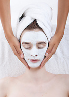 Young woman receiving facial treatment at spa