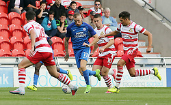 Marcus Maddison of Peterborough United takes on the Doncaster Rovers defence - Mandatory by-line: Joe Dent/JMP - 02/09/2017 - FOOTBALL - The Keepmoat Stadium - Doncaster, England - Doncaster Rovers v Peterborough United - Sky Bet League One