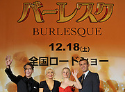 Singer and actress Christina Aguilera (2L) attends a red carpet event with film director Steven Antin, actress Kristen Bell (3L) and actor Cam Gigandet (far R) to promote their film Burlesque in Tokyo, Japan on Dec. 8 2010.
