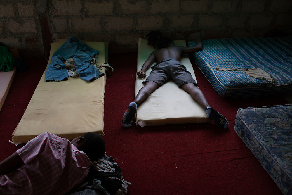 Oscar Suazo(center top) and Andres Sanchez sleep in a migrant shelter in Tenosique, Tabasco.  The two men are cousins from Honduras and are planning to ride a freight train north to the border with the United States.  The trip for these migrants, mostly from Central America,  has become increasingly dangerous over the past several years as Mexico's drug war has raged and kidnappings and killings of migrants has increased.