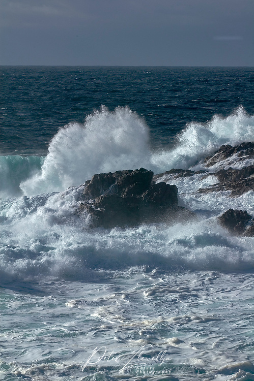 Stormy seas brerak on to rocks at Amphitrite Point on the Wild Pacific Trail   Photo: Peter LLewellyn