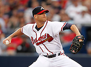 ATLANTA - AUGUST 13:  Pitcher Tim Hudson #15 of the Atlanta Braves throws a pitch during the game against the Los Angeles Dodgers at Turner Field on August 13, 2010 in Atlanta, Georgia.  (Photo by Mike Zarrilli/Getty Images)