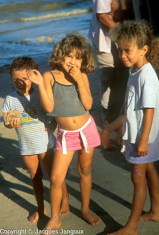 Children of fishermen at beach of fishing village in Alagoas State, Brazil.