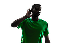 one african man soccer player green jersey hearing gesture in silhouette on white background