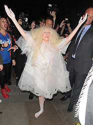 Lady GaGa wearing a see-through white dress, painted hands and feet as she arrives at a London hotel. UK. 25/10/2013<br />