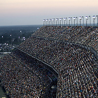 Spectators fill the stands during the 60th Annual NASCAR Daytona 500 auto race at Daytona International Speedway on Sunday, February 18, 2018 in Daytona Beach, Florida.  (Alex Menendez via AP)