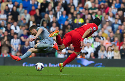 LIVERPOOL, ENGLAND - Sunday, May 11, 2014: Liverpool's Luis Suarez is tackled by Newcastle United's Paul Dummett during the Premiership match at Anfield. (Pic by David Rawcliffe/Propaganda)