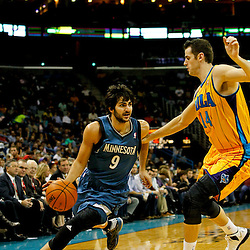 Jan 11, 2013; New Orleans, LA, USA; Minnesota Timberwolves point guard Ricky Rubio (9) drives past New Orleans Hornets power forward Jason Smith (14) during the first quarter of a game at the New Orleans Arena. The Hornets defeated the Timberwolves 104-92. Mandatory Credit: Derick E. Hingle-USA TODAY Sports