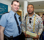21/05/2013 Repro free.  Community Garda Hugh Rodgers and Chris Okeke Nigeria at the launch of Africa Day 2013 at Galway City Museum by Galway City Council and Irish Aid  . ..Africa Day falls on 25th May each year, with events taking place around the country from 20th-27th May. It is an initiative of the African Union, and aims to celebrate African diversity and success and the cultural and economic potential of the continent. In Ireland, events to mark Africa Day are supported by Irish Aid, the Government's programme for overseas development and Galway City Council...The events planned by Galway City Council will take place on 21st May and from 24th to 26th May. Galway City Council are launching Africa Day 2013 by Mayor of Galway City Cllr Terry O'Flaherty on Tuesday 21stMay @ 11:00 a.m.at the Galway City Museum with inputs from the African Ambassadors Network, Africian Film Festival, NUIG and music by South Africian Choirs. Picture:Andrew Downes