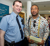 21/05/2013 Repro free.  Community Garda Hugh Rodgers and Chris Okeke Nigeria at the launch of Africa Day 2013 at Galway City Museum by Galway City Council and Irish Aid  . ..Africa Day falls on 25th May each year, with events taking place around the country from 20th-27th May.  It is an initiative of the African Union, and aims to celebrate African diversity and success and the cultural and economic potential of the continent.  In Ireland, events to mark Africa Day are supported by Irish Aid, the Government's programme for overseas development and Galway City Council.. .The events planned by Galway City Council will take place on 21st May and from 24th to 26th May.  Galway City Council are launching Africa Day 2013 by Mayor of Galway City Cllr Terry O'Flaherty on Tuesday 21st May @ 11:00 a.m.at the Galway City Museum with inputs from the African Ambassadors Network, Africian Film Festival, NUIG and music by South Africian Choirs. Picture:Andrew Downes
